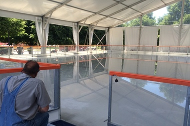 Workers put the finishing touches on Navy Pier's new outdoor ice rink Wednesday.