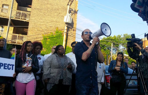 David Sotomayor speaking at a vigil in Boystown Sunday night