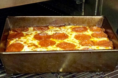 A pepperoni pizza in the oven at Jet's Pizza in Wicker Park. The Michigan-based pizza chain is selling 20-cent slices Monday.
