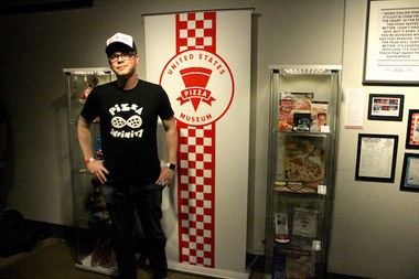U.S. Pizza Museum curator Kendall Bruns stands beside the first live exhibit of his collection at the Chicago Pizza Summit on April 3.