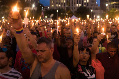 People gathering for a candlelight vigil last week in Orlando.