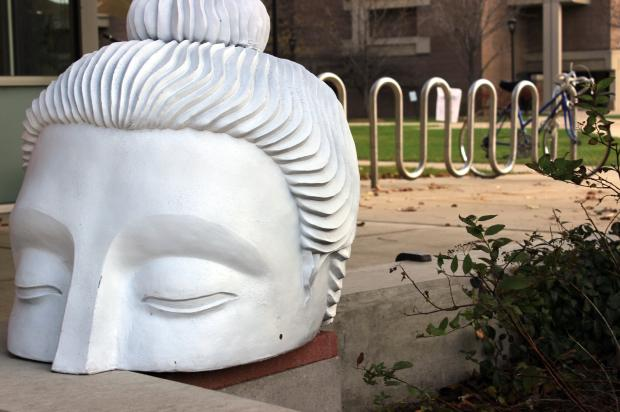 "Buddha sculptures part of ""Ten Thousand Ripples"" public art installation."