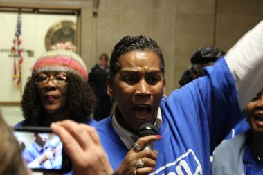 Windy Pearson, of the citizens' group Action Now, leads chants for a moratorium on Chicago Public Schools closings in a protest at City Hall Friday.