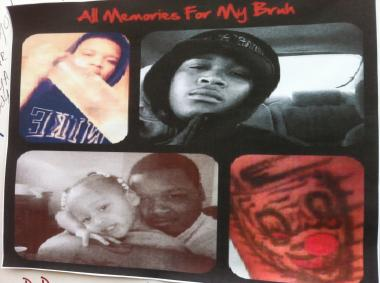 A photo collage of Devon Greer is part of a memorial poster board hanging Oct. 29, 2012, on the apartment building where he was killed. Greer, 21, was sitting in a Humboldt Park apartment early on Oct. 27 when bullets were fired from outside, fatally striking him in the back.