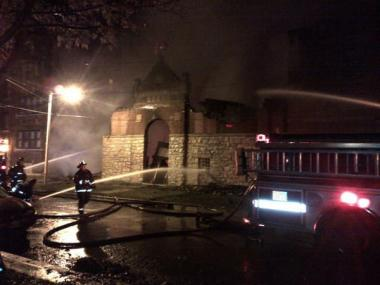 Firefighters battle an extra-alarm fire at Love, Faith and Praise Church of God in Christ, 6948 S. Stewart Ave., in Englewood early Friday.
