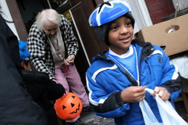 A young boy goes trick-or-treating in Chicago.
