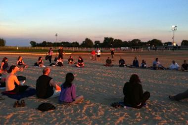 The weekly group moved its meditation to the beach over the summer for an added element of distraction and challenge.
