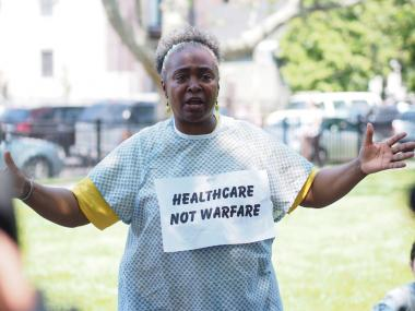 Mental Health activist N'Dana Carter at a demonstration protesting clinic closures.