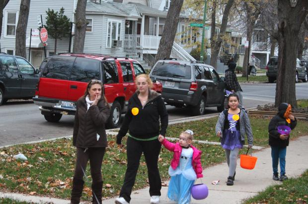 Trick-or-treaters head toward an Operation Porchlight house; Oct. 31, 2012.