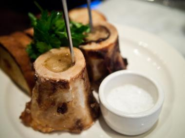 Bone marrow served with coarse salt and toast at The Purple Pig, one of 64 Chicago restaurants recognized on Michelin's 2013 Bib Gourmand list.