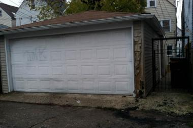 The flaming trash can that an unknown man was found in Tuesday night singed the siding off a garage.