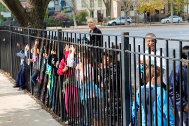 LaSalle Language Academy students line a fence during recess to watch the school's Long Distance Classic race on Oct. 17, 2012.
