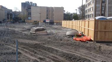 Crews work on a vacant lot at 4700 N. Clarendon Ave., which is part of a TIF district the mayor wants to dissolve. It could now become a parking lot and garden space for a children's psychiatric hospital.
