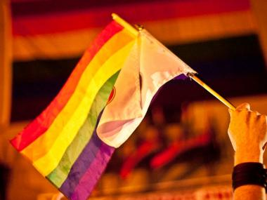 A rainbow flag waves outside the historic Stonewall Inn after the gay marriage bill passed on June 24, 2011.