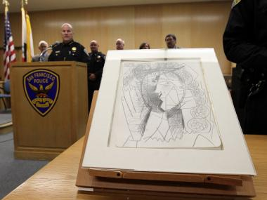 San Francisco police showed off the recovered Picasso drawing,