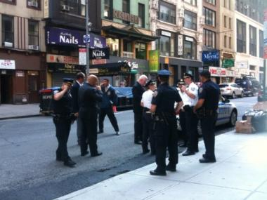 Police investigate the scene of a hit and run at 29 W. 46th St. on Saturday, July 9, 2011.