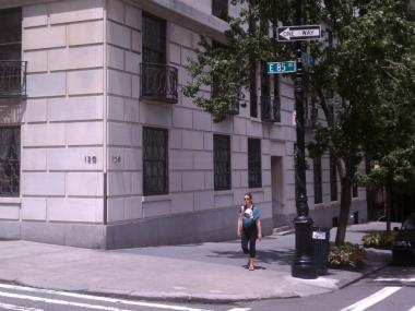 A woman walks by the corner of East 85th Street and East End Avenue, the scene of a sexual assault on July 13, 2011.