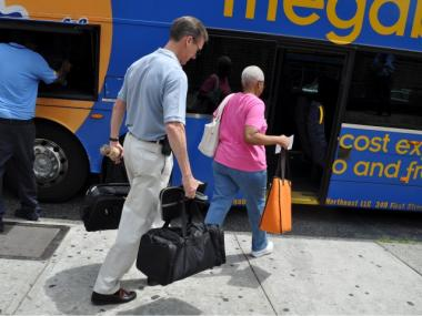 Passengers boarded the Megabus July 13, 2011.