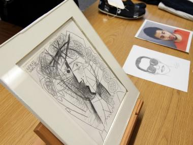 A mug shot and sketch of burglary suspect Mark Lugo are displayed next to a Picasso drawing that San Francisco police recovered less than 48 hours after it was stolen from the Weinstein Gallery July 7, 2011 in San Francisco, California.