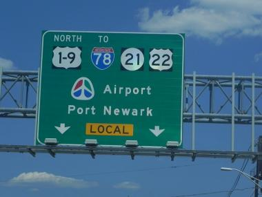 A road sign indicating the way to Newark Airport.