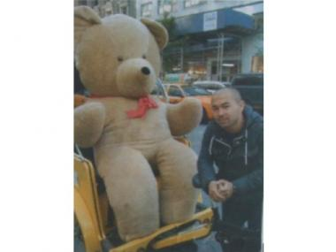 Firdaus Nazarov pictured next to a giant teddy bear, is being sought by the NYPD