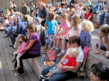 Children enjoy a free storytelling event at the High Line during the summer.