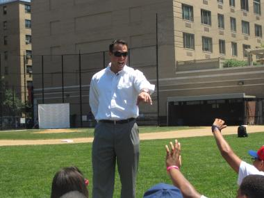 Yankees first baseman Mark Teixeira takes questions from kids at Harlem RBI whose summer jobs he helped fund by soliciting adonation from Walmart.