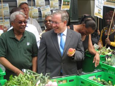 Corbin Hill Road Farm founder Dennis Deryck and Manhattan Borough President Scott Stringer outside of a new distribution site on West 132 Street and Amsterdam Avenue in Harlem.
