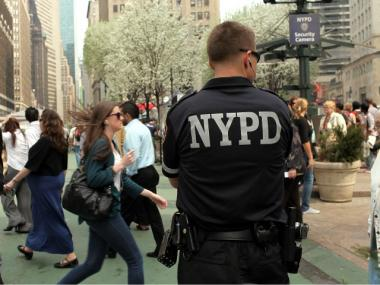 A New York City police officer stands on patrol on April 6, 2010 in New York City.