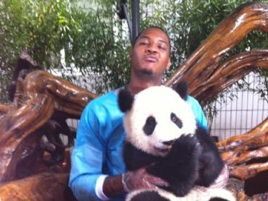 Knicks guard Carmelo Anthony hugs a panda during a promotional tour of China on July 28, 2011.