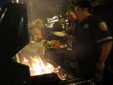 Police and auxiliary officers cooked up hotdogs and hamburgers at the Sixth Precinct's National Night Out block party in Greenwich Village Tuesday, July 2, 2011.