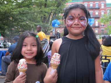 Isabella Ramires, six, (left), with sister Kayla, five, loved her face painting.