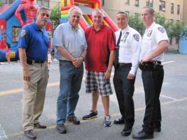 (L-R) Detective Jaime Hernandez, 9th Precinct Community Council President Jerry Shea, Lieutenant Patrick Ferguson, Deputy Inspector Kenneth Lehr and Captain Brendan Timoney celebrated National Night Out on Tues., Aug. 3., 2011.