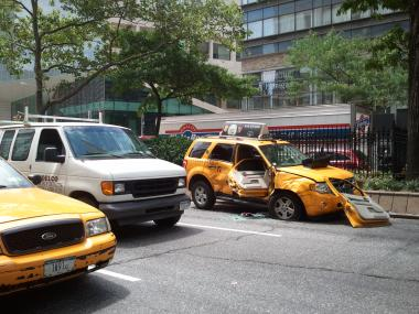 A taxi was smashed in a crash with a bus on Aug. 3 on Broadway and West 66th Street.