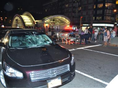 A car with a shattered windshield remained at the scene of the accident.