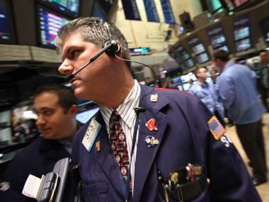 Traders work on the floor of the New York Stock Exchange during afternoon trading on August 5, 2011 in New York City. Stocks closed up 60 points after finishing down 512 in yesterday's session.