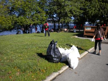 A group of volunteers pick up trash in Inwood Hill Park. The Parks Department is now looking to residents for suggestions on how to keep parks clean.