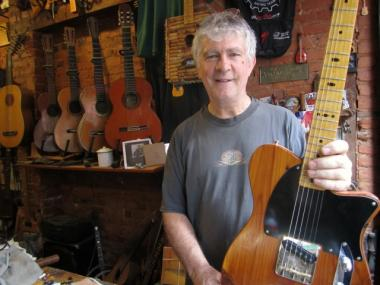 Rick Kelly, photographed on Wednesday, Aug. 10, 2011, opened a guitar shop on Downing Street in 1976 and moved to Carmine Street in 1990.