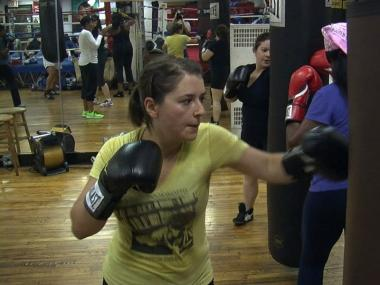 Sasha de Vogel trains on a punching bag at Women's World of Boxing.