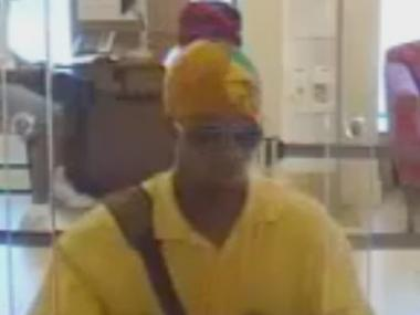 Police are looking for this man in connection with two Harlem bank robberies in August 2011.