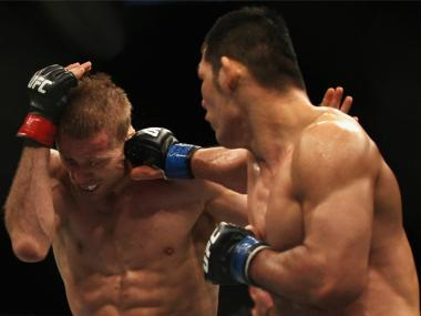 Riki Fukuda punches Nick Ring at UFC 127. Fans can watch similar fights screened in Times Square on Saturday.