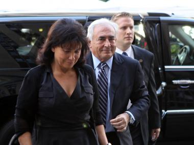 Dominique Strauss-Kahn entered Manhattan Supreme Court with his wife, Anne Sinclair, by his side on Tues, Aug. 23, 2011.