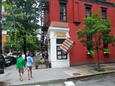 Strong winds overnight on Sunday, Aug. 28, 2011 ripped off a business' awning on Hudson Street at Perry Street.