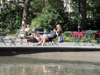 Sunbathers relaxed in Madison Square Park Aug. 29, 2011, one day after Hurricane Irene.