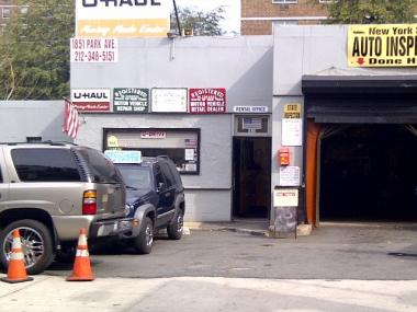 A worker at the garage at 1851 Park Ave. was one of four people arrested for allegedly issuing false inspection materials.