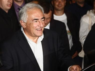 Former IMF chief Dominique Strauss-Kahn arrives at Aeroport Roissy Charles de Gaulle with his wife Anne Sinclair (not pictured) on September 4, 2011 in Roissy, France.Strauss-Kahn has returned to France from the United States following the dismissal two weeks earlier of sexual assault and attempted rape charges by U.S. legal authorities.