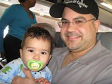 John Collado, with his grandchild, was shot and killed by a police officer on Sept. 7, 2011.