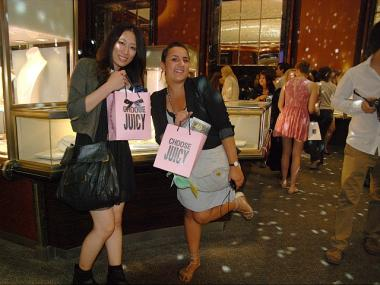 Shoppers Yuka Otomo, 22, and Alex Casanova, 23, show off their purchases in Tiffany's.