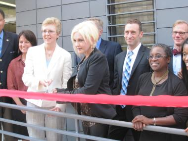 Cyndi Lauper cuts the ceremonial ribbon at the True Colors Residence, the first permanent housing for LGBT Youth in New York State.