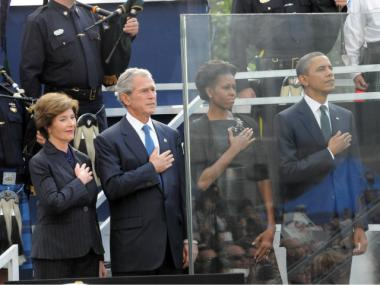 (L-R) Laura and George Bush stand beside Michelle and Barack Obama at the 10th anniversary service at the World Trade Center site, Sept. 11, 2011.
